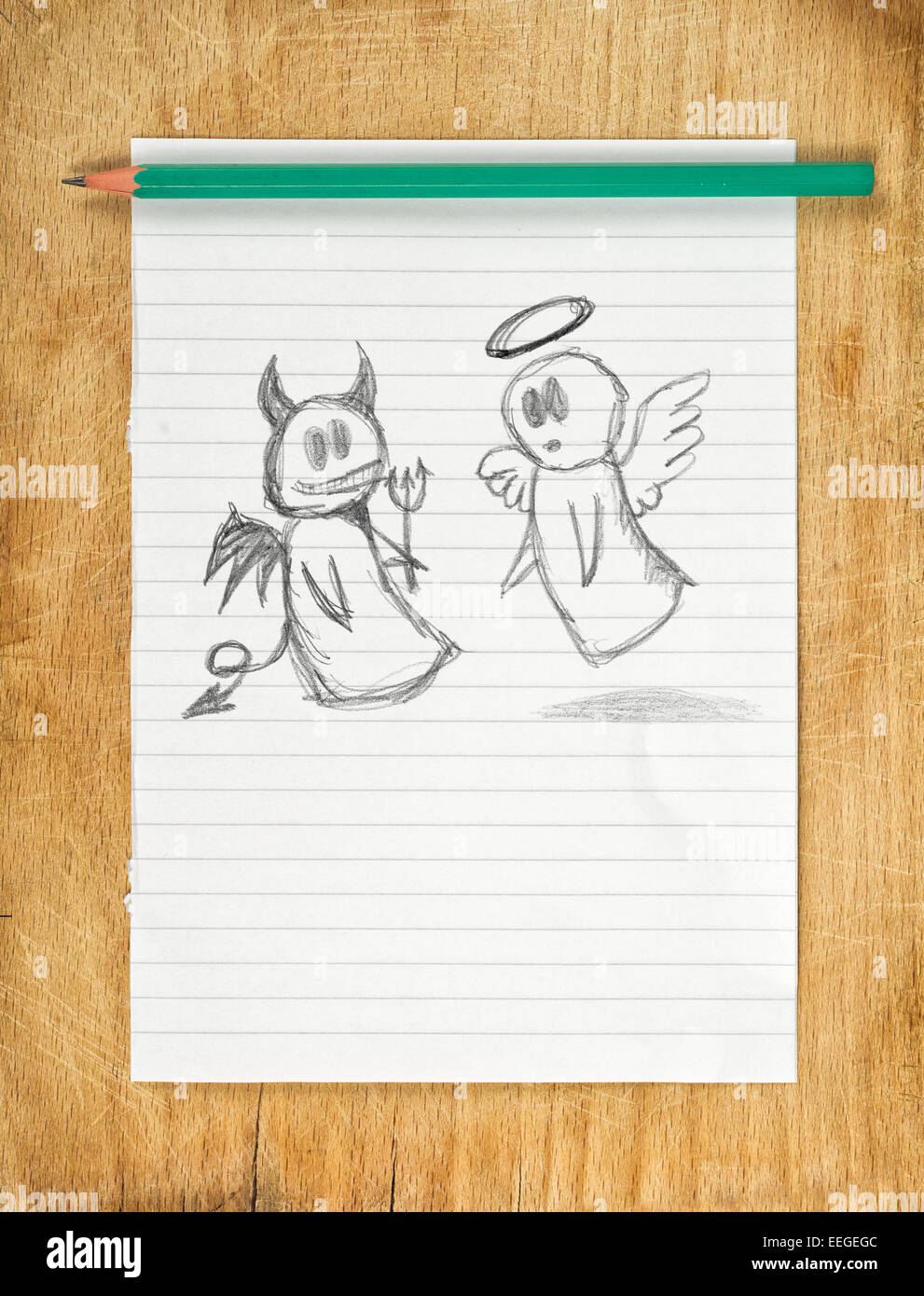 Doodle drawing of angel and devil on white paper as concept of conscience and moral dilemma in fight of good and - Stock Image