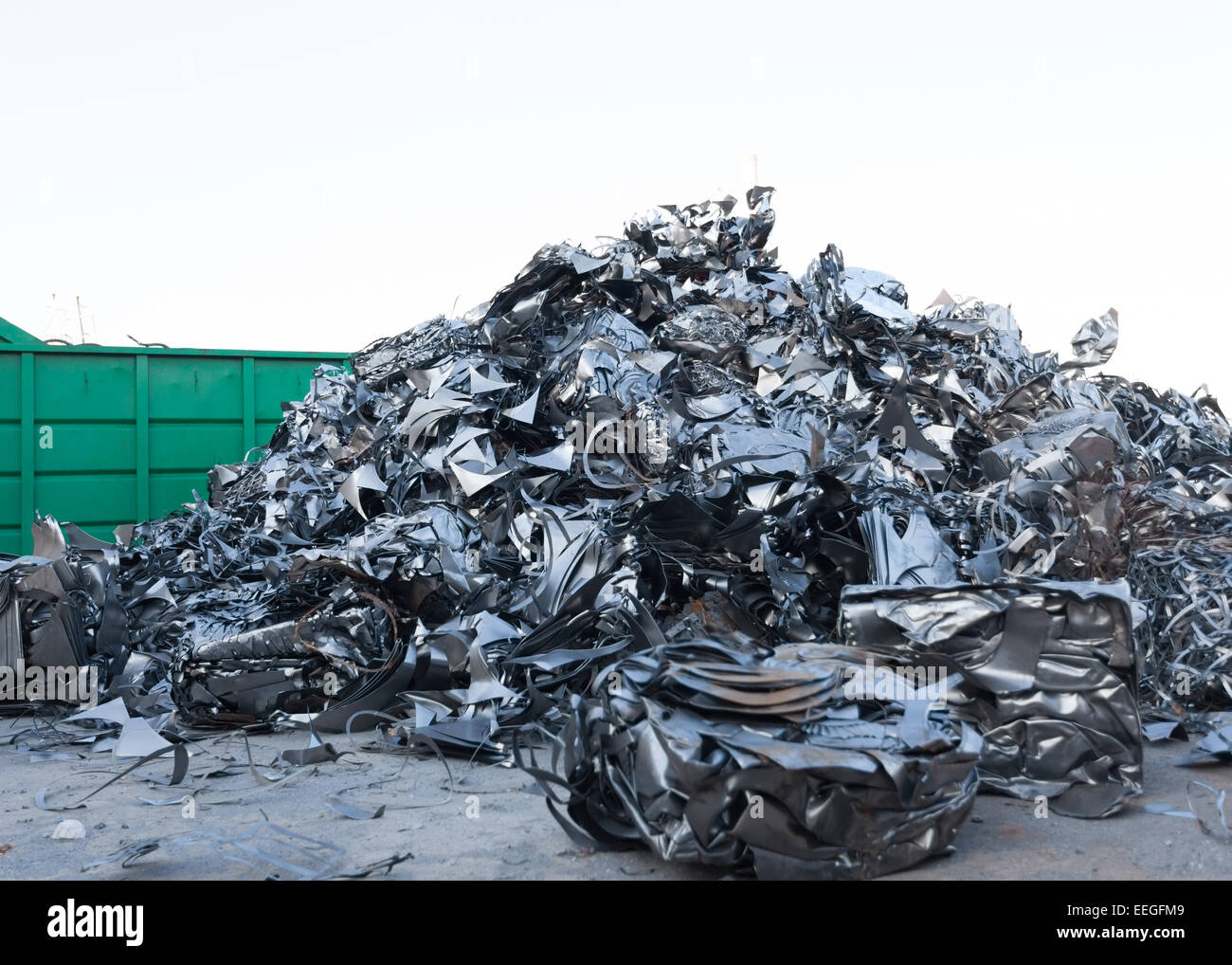 pile of shiny metal parts in recycling junkyard - Stock Image