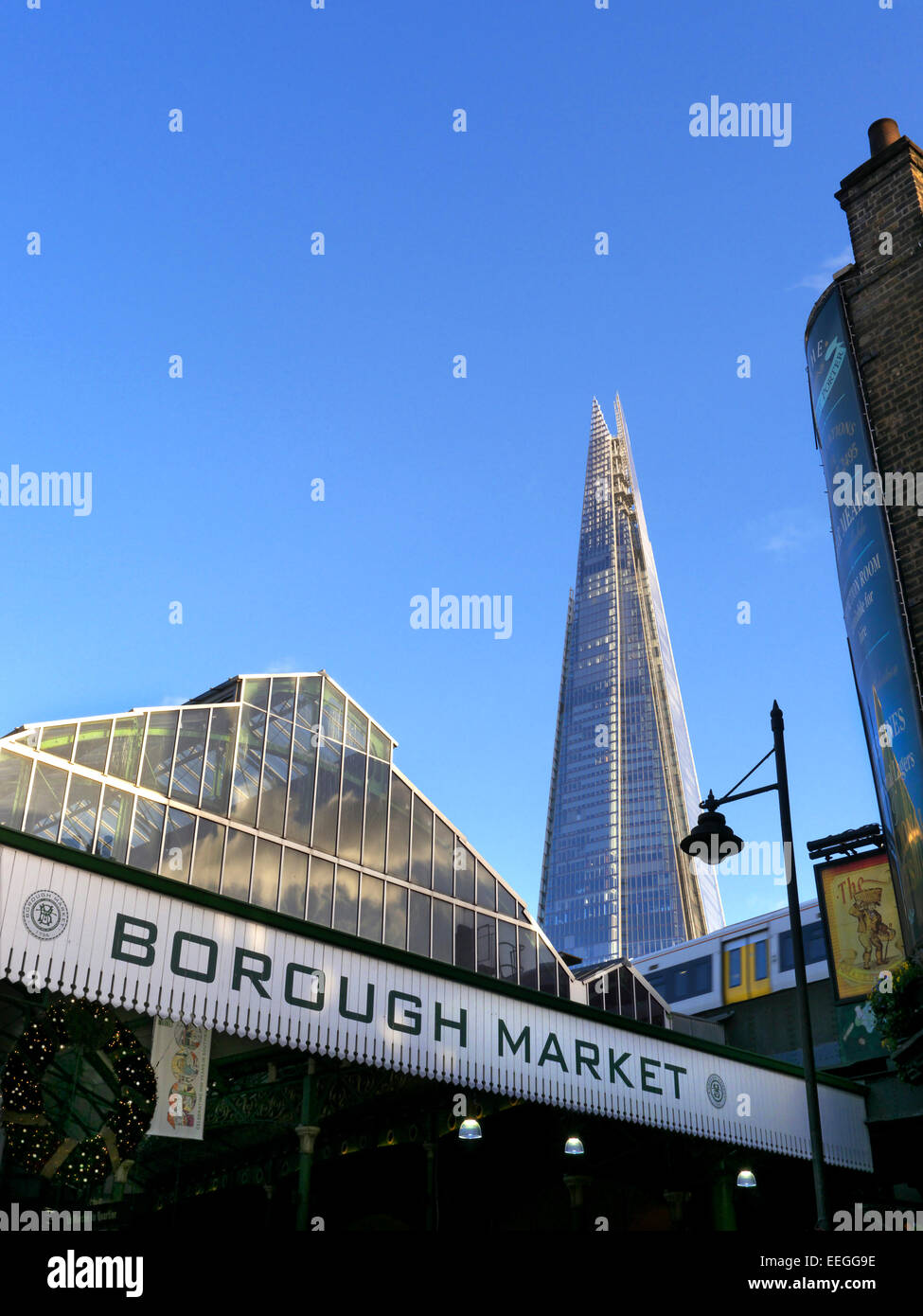 Borough Market a renowned popular international produce retail market with 'The Shard' behind London Bridge - Stock Image