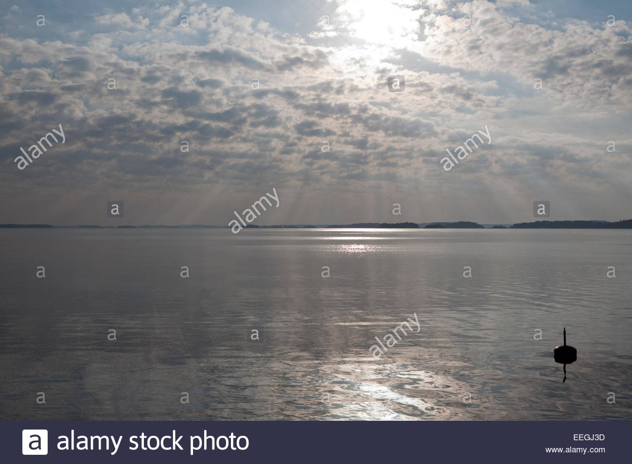 Sunlight between clouds in the archipelago - Stock Image