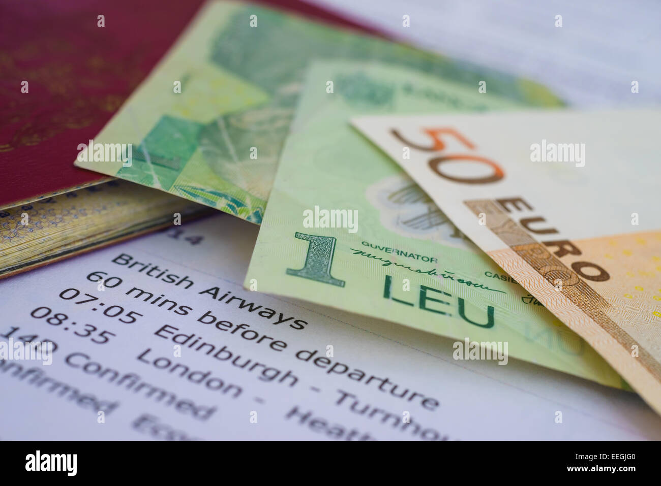 Travel documents, passport, foreign money (Euro and Romanian Leu) and flight itinerary for travelling. - Stock Image