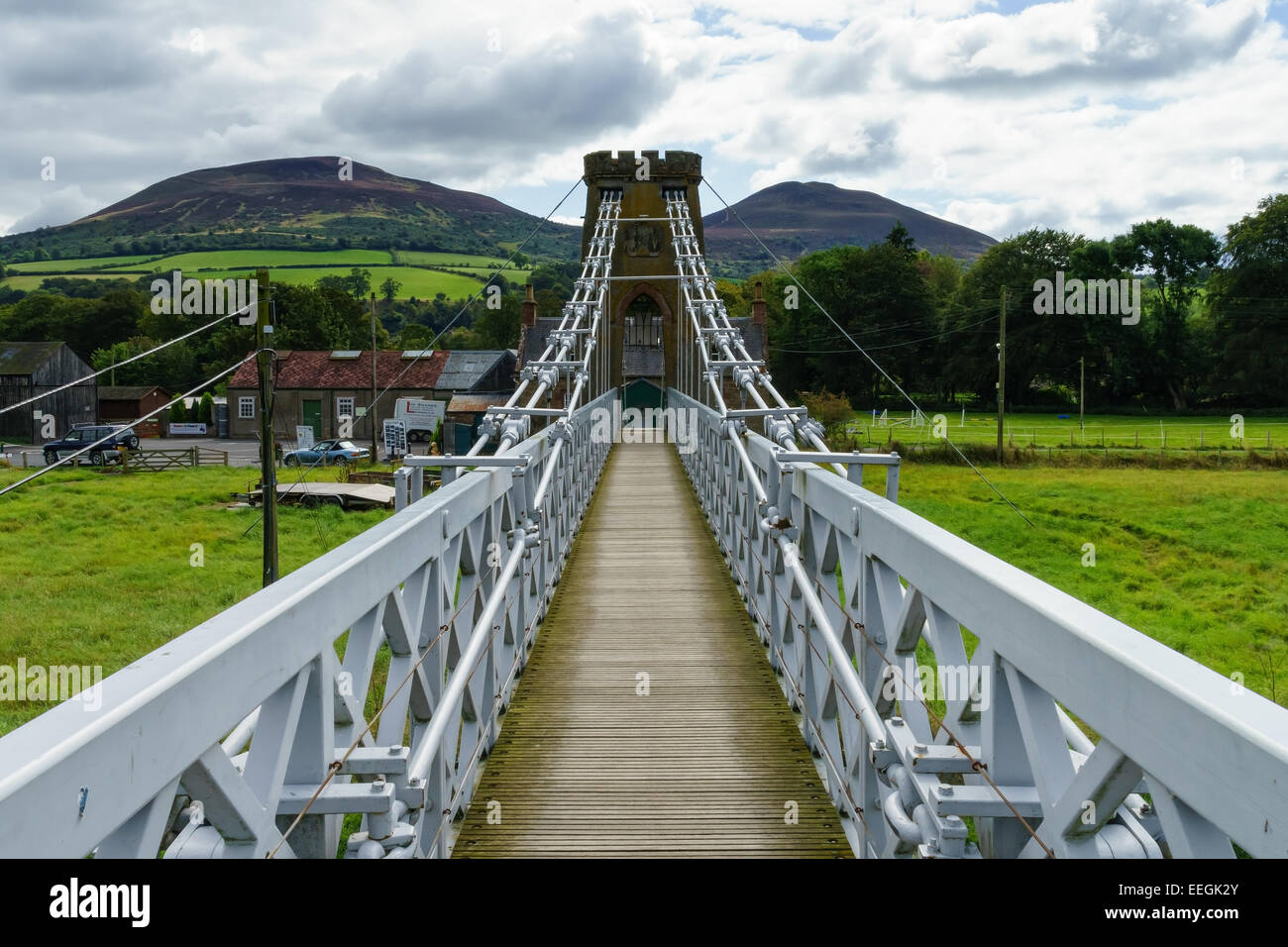 The iron suspension chainbridge across the River Tweed at Melrose, Scottish Borders. The Eildon Hills in the background. - Stock Image