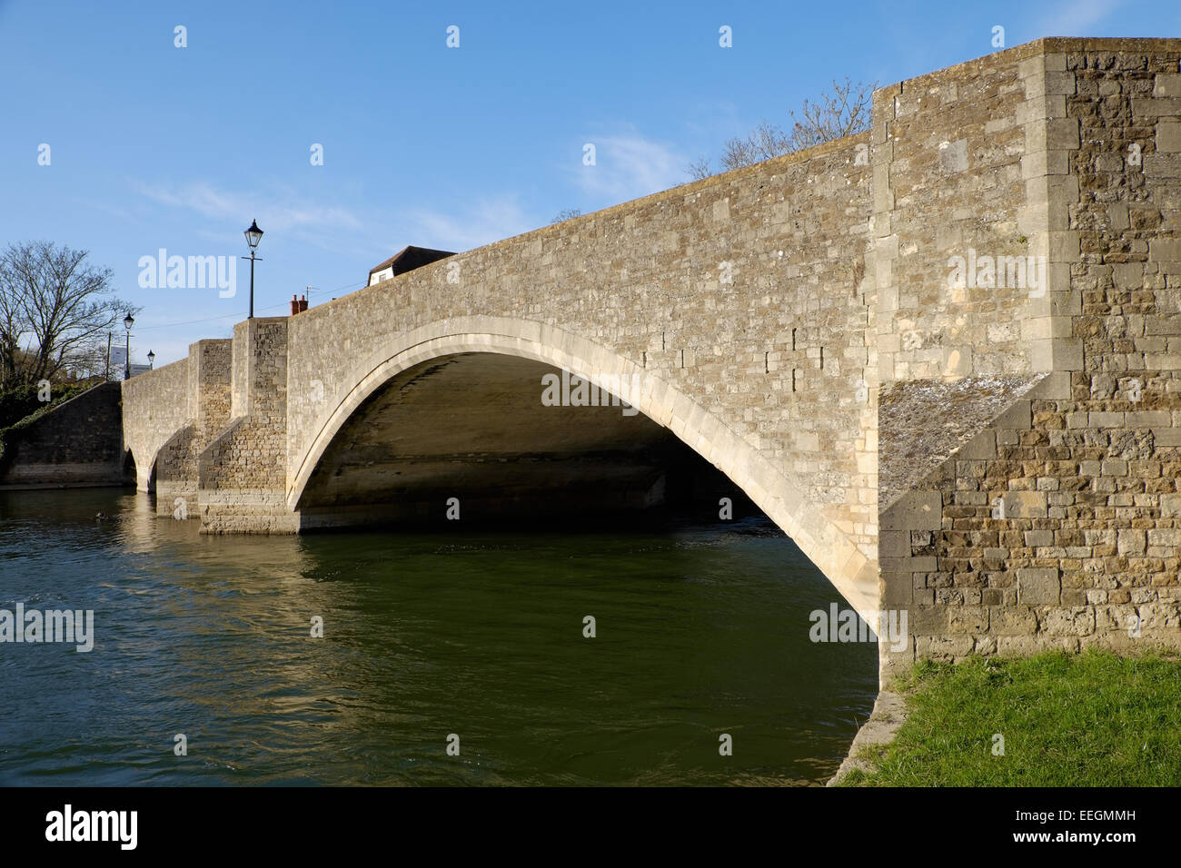 The old stone road bridge over the River Thames, in Abingdon, Oxfordshire. - Stock Image