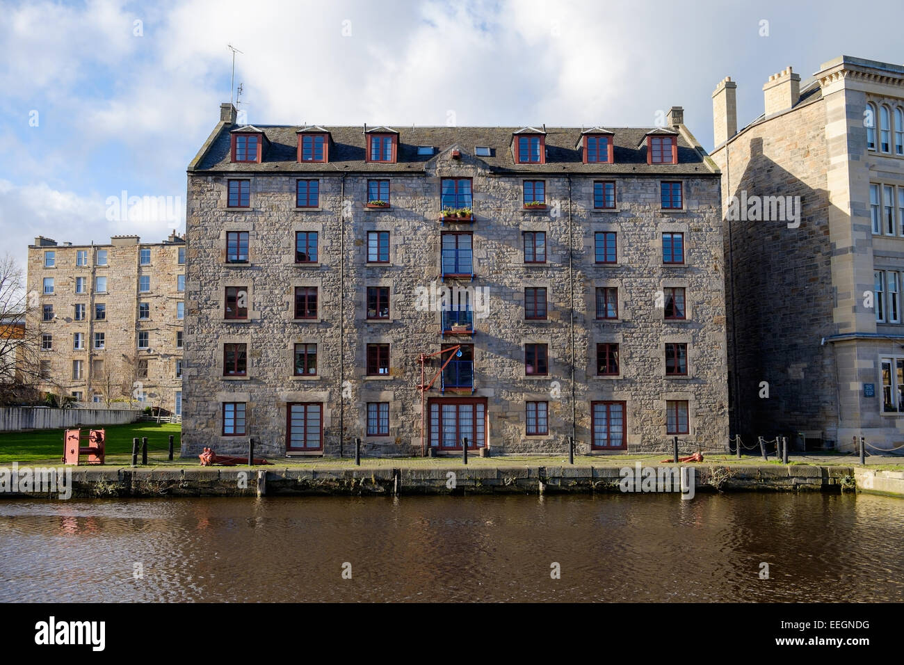 An old warehouse converted to flats in Leith docks, Edinburgh, Scotland. - Stock Image