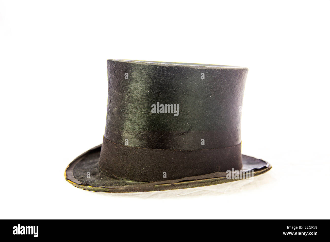 top hat old antique worn torn threadbare posh used cut out copy space white background - Stock Image
