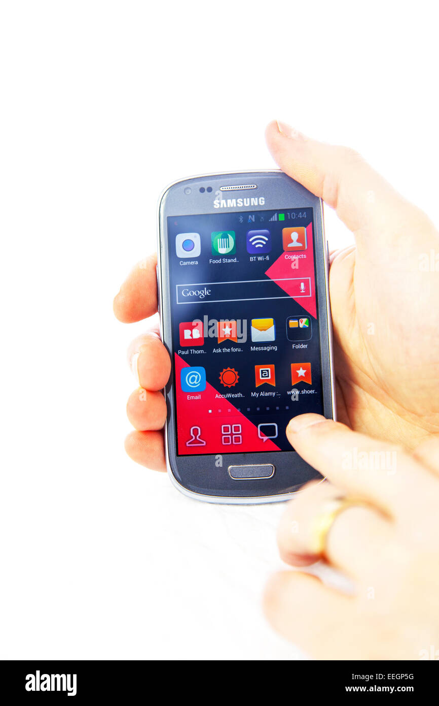 using smartphone samsung galaxy hands S3 phone mobile tapping cut out copy space white background operating touch - Stock Image