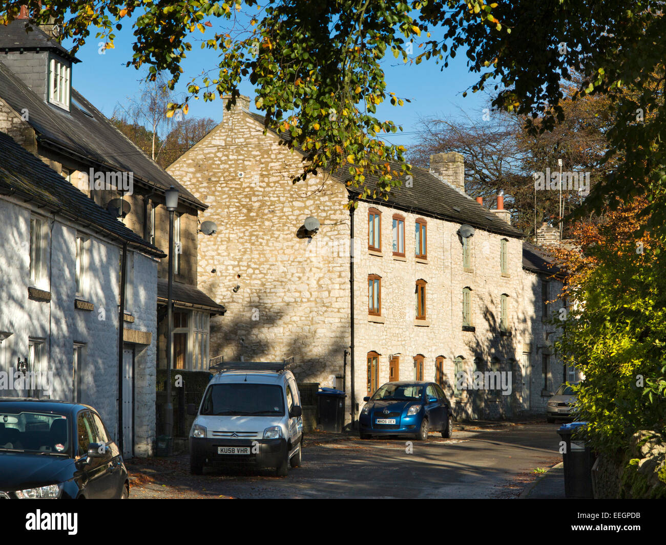 UK, Derbyshire, Tideswell, Sherwood Road, newly renovated former silk mill amongst terraced cottages - Stock Image