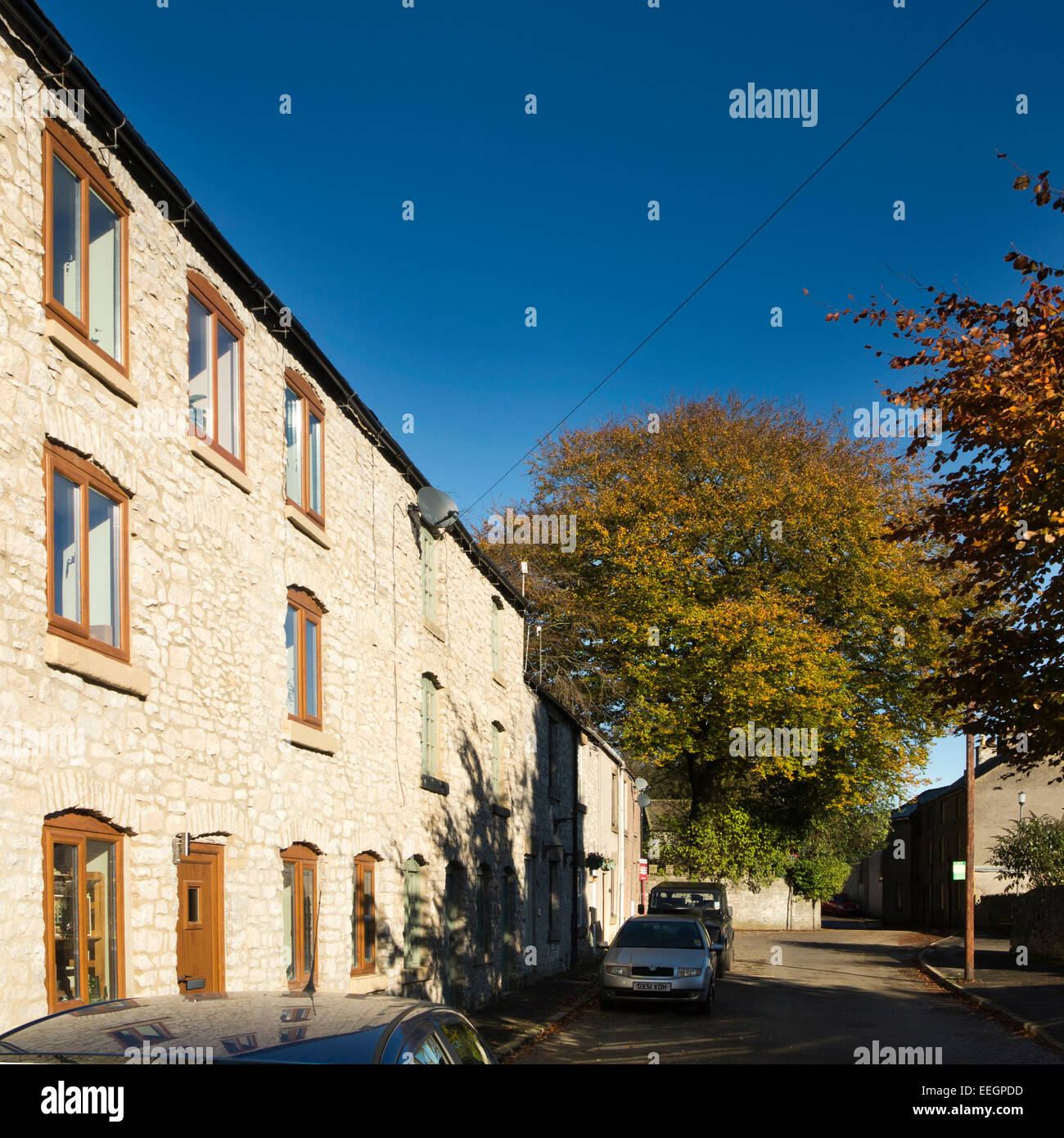 UK, Derbyshire, Tideswell, Sherwood Road, newly renovated former silk mill in autumn - Stock Image