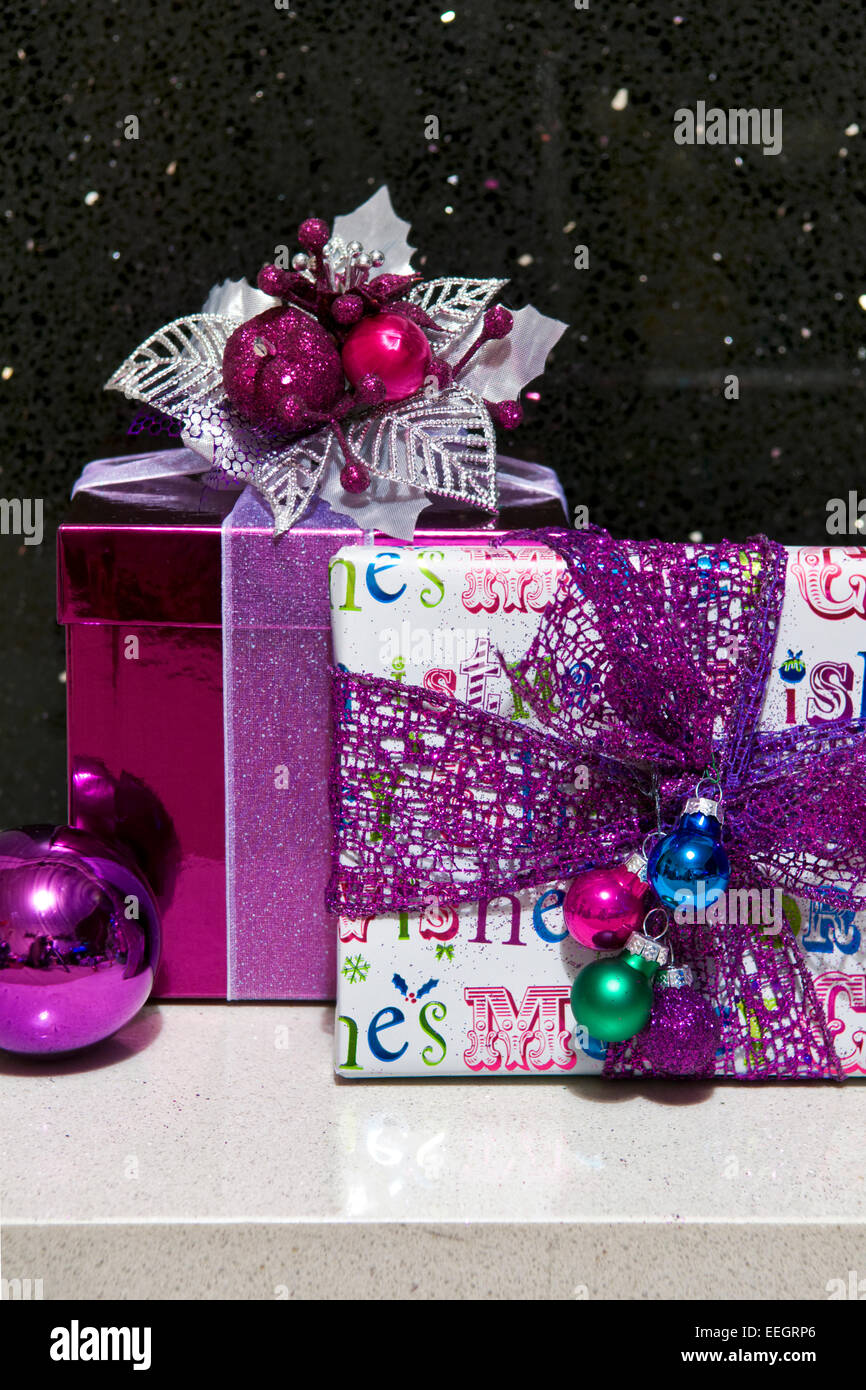 Close up of prettily wrapped Chistmas presents in modern theme and colours - Stock Image