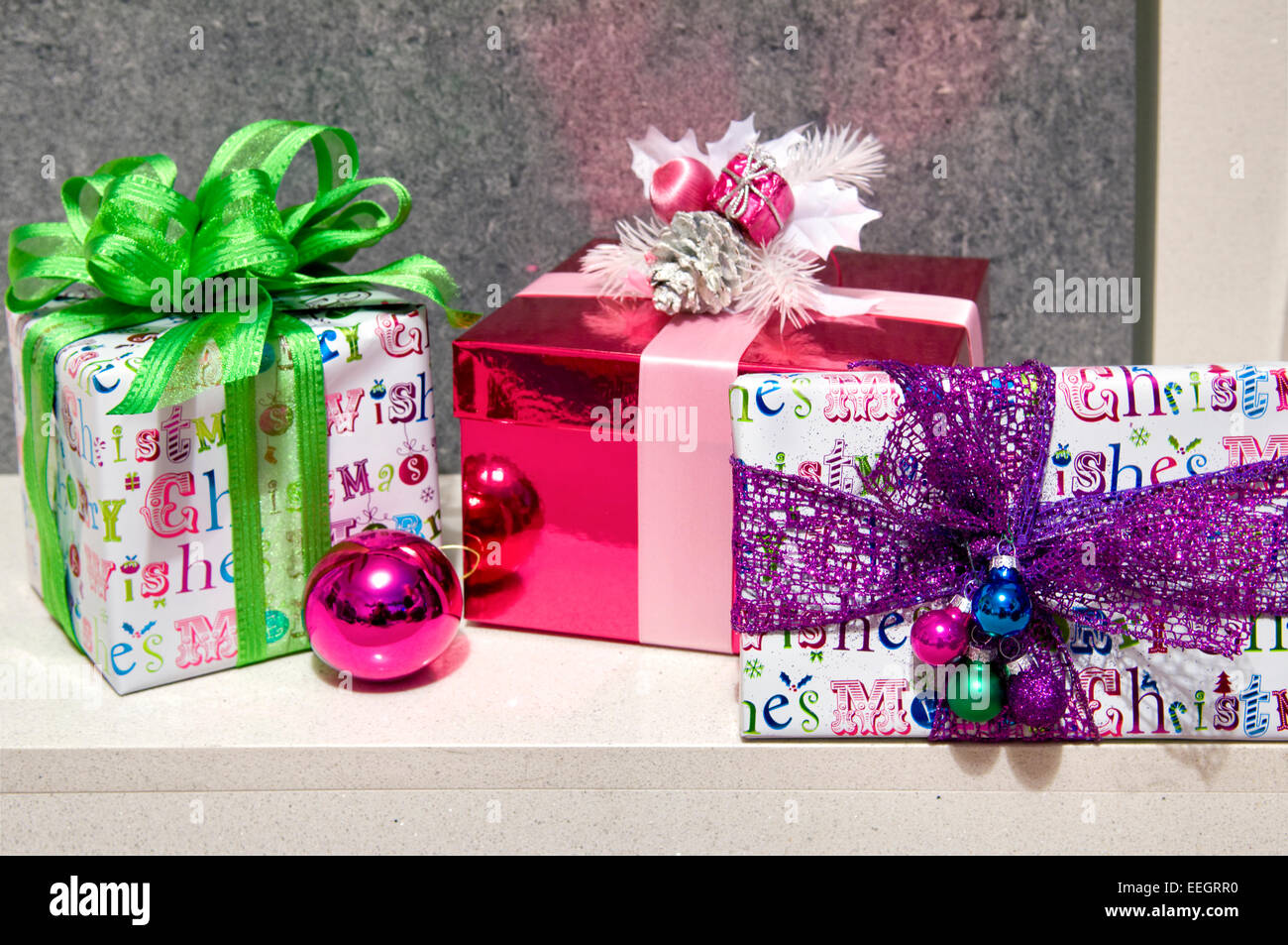 Close up of prettily wrapped Chistmas presents in modern themes and colours - Stock Image