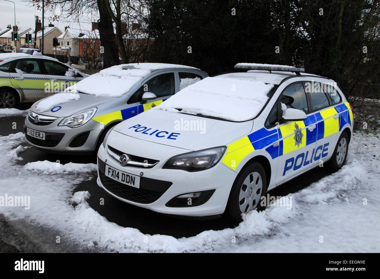 Police cars in the snow Vauxhall (MG) and Fords, not much between them in cost and quality, except Ford use stronger - Stock Image