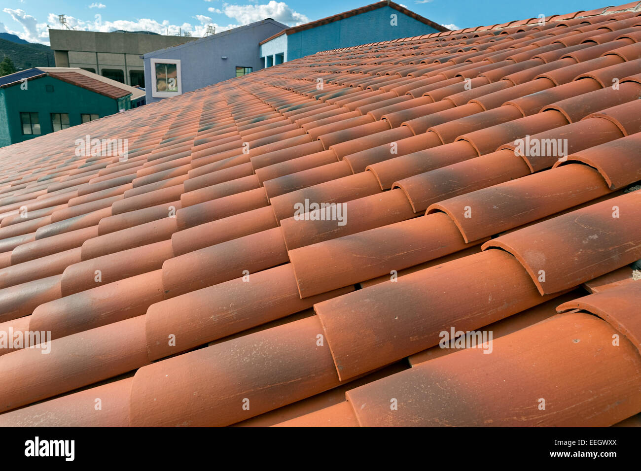 Looking across a red Spanish tiled roof, Tucson, Arizona - Stock Image