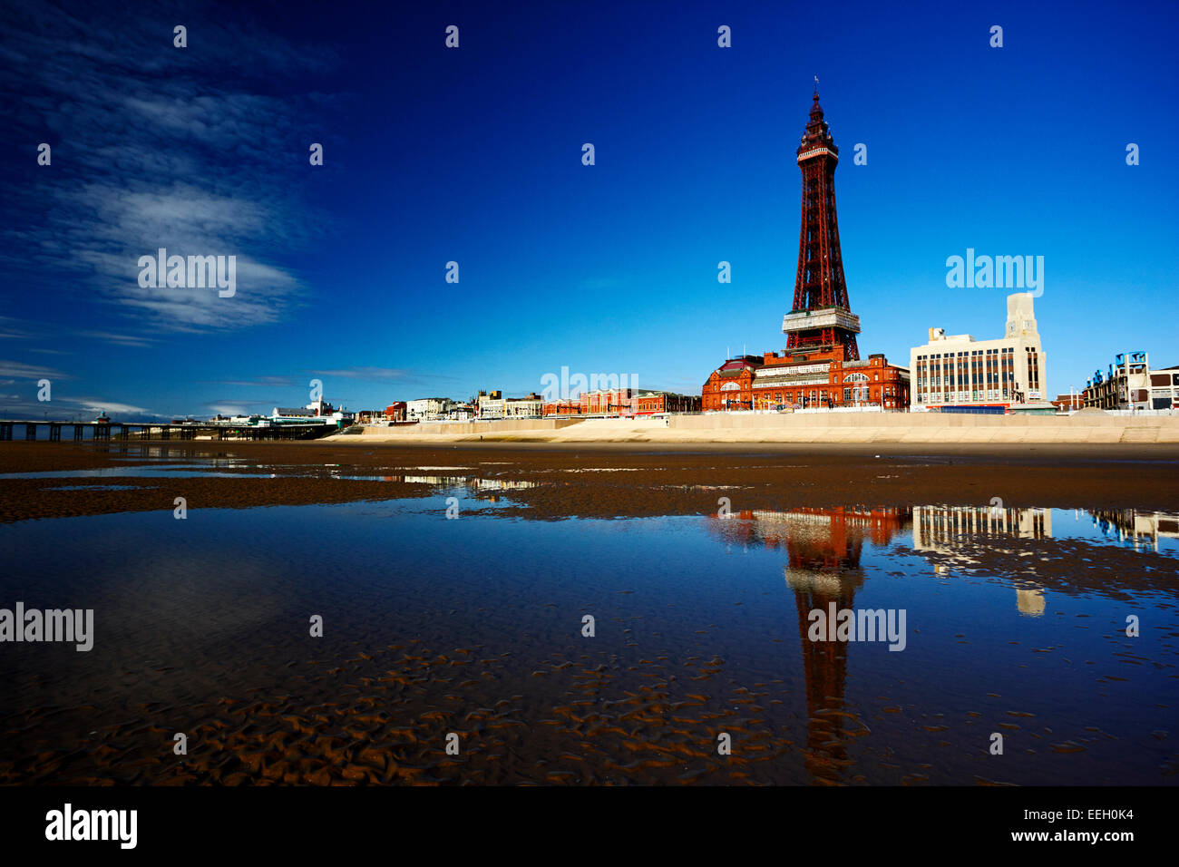 reflection of Blackpool tower and seafront promenade in pool on the beach lancashire england uk - Stock Image
