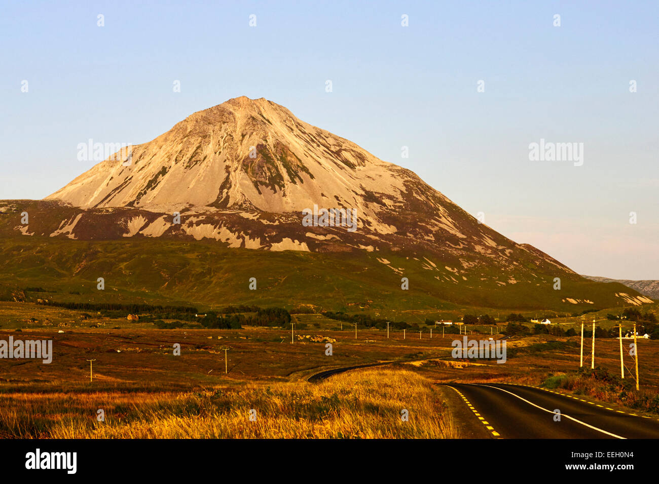 sunset over road through donegal past Errigal mountain in County Donegal Ireland - Stock Image