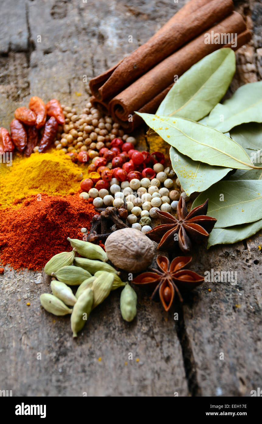 Herbs and spices selection, on wooden table background - Stock Image