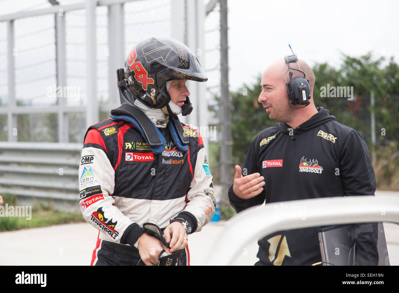 ISTANBUL, TURKEY - OCTOBER 11, 2014: Petter Solberg talk with his mechanic before FIA World Rallycross Championship. - Stock Image