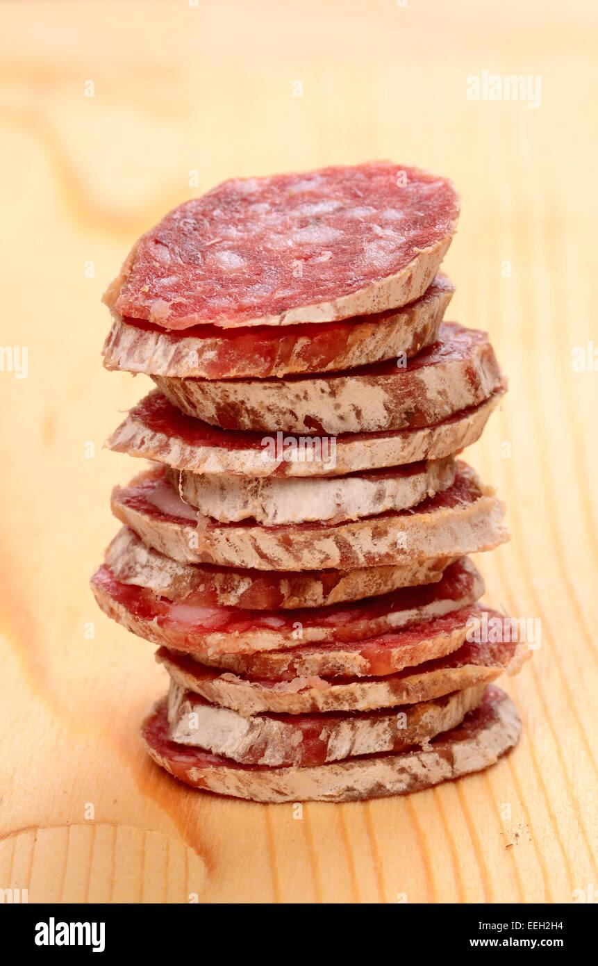 Sliced salami close-up shot - Stock Image