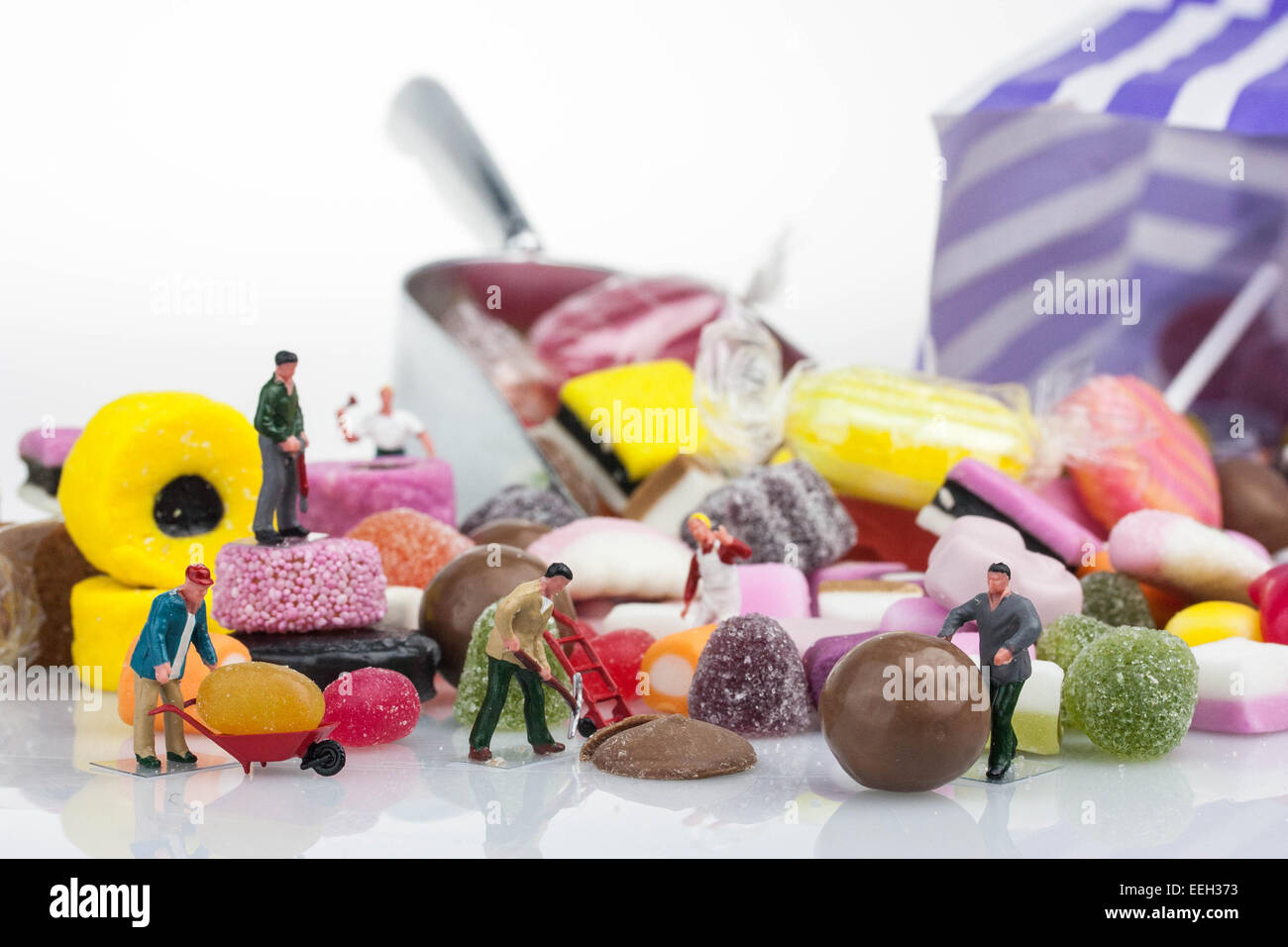 Sweets - Minuture people - Stock Image