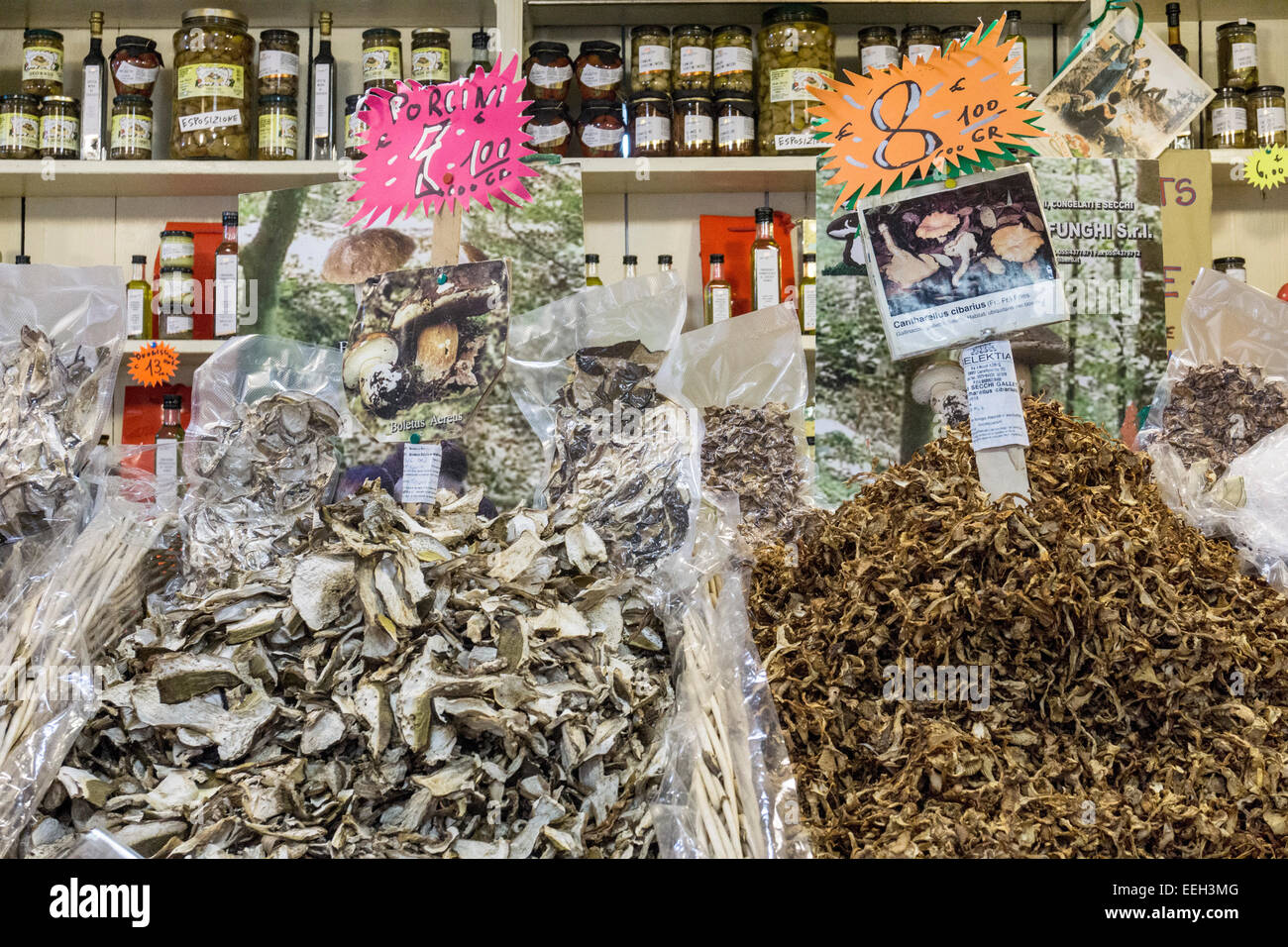 incredible variety including Porcini dried gourmet mushrooms displayed in open baskets & cellophane packages - Stock Image