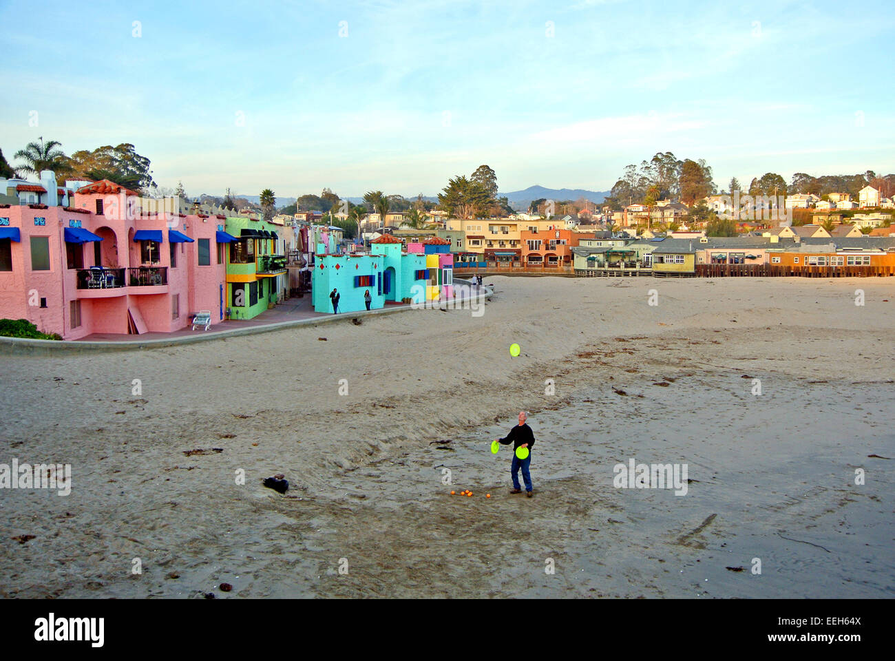 man juggling on beach in Capitola california - Stock Image
