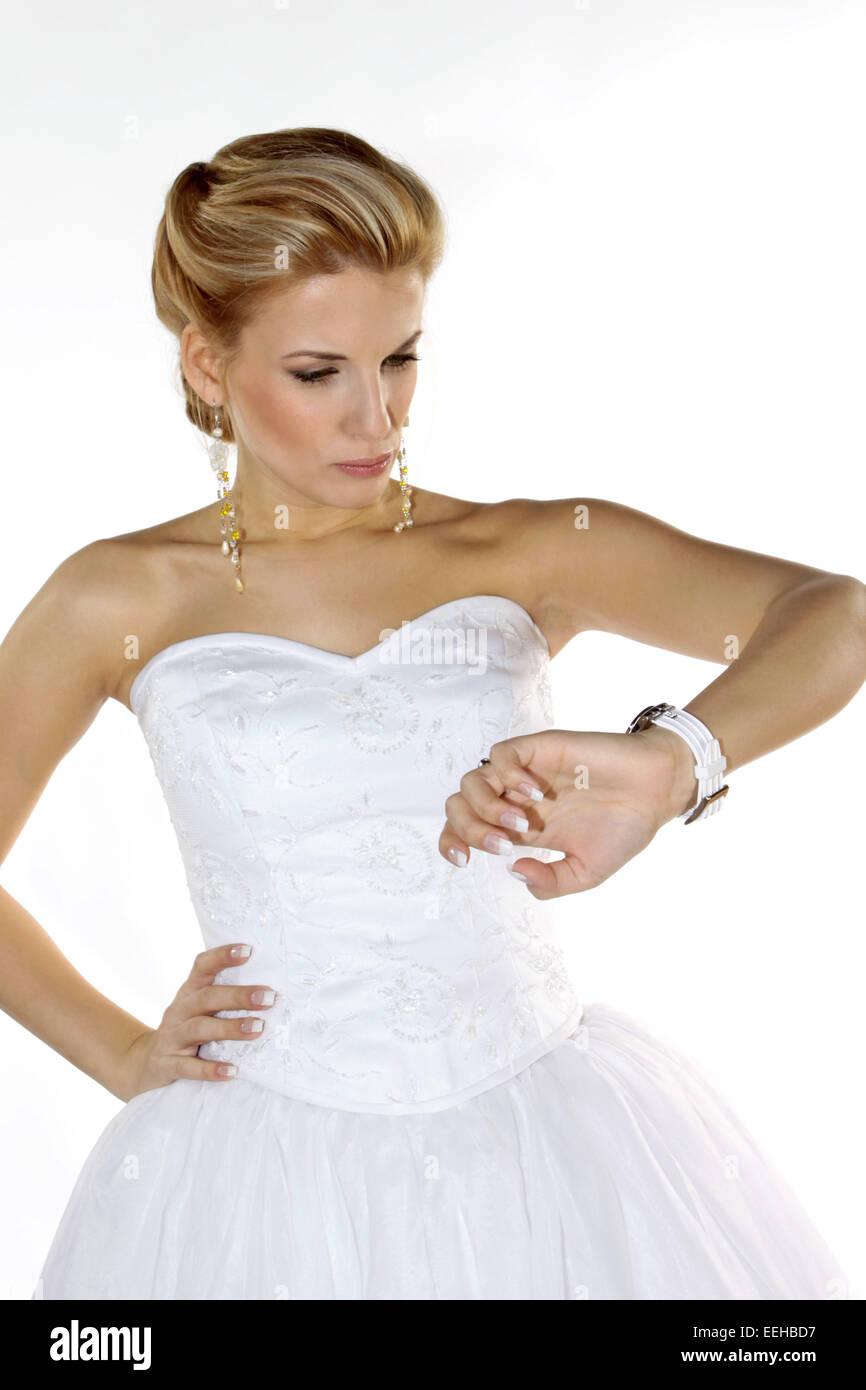 Braut, Hochzeit, Heirat, Heiraten, Brautkleid, wuetend, wartend, auf die Uhr schauend (Modellfreigabe) Stock Photo