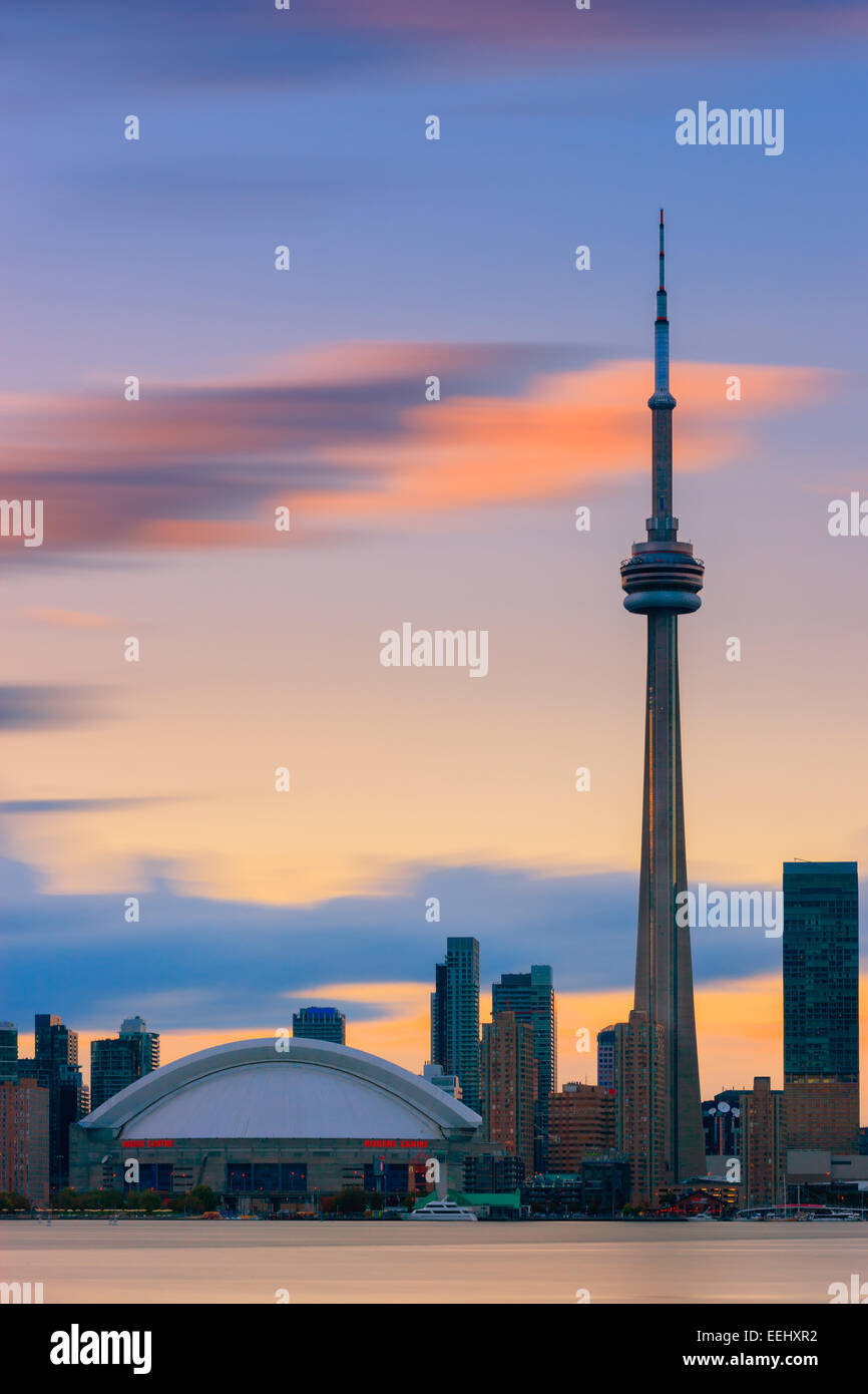 Toronto CN Tower at sunset with a long exposure, taken from the Toronto Islands. Stock Photo