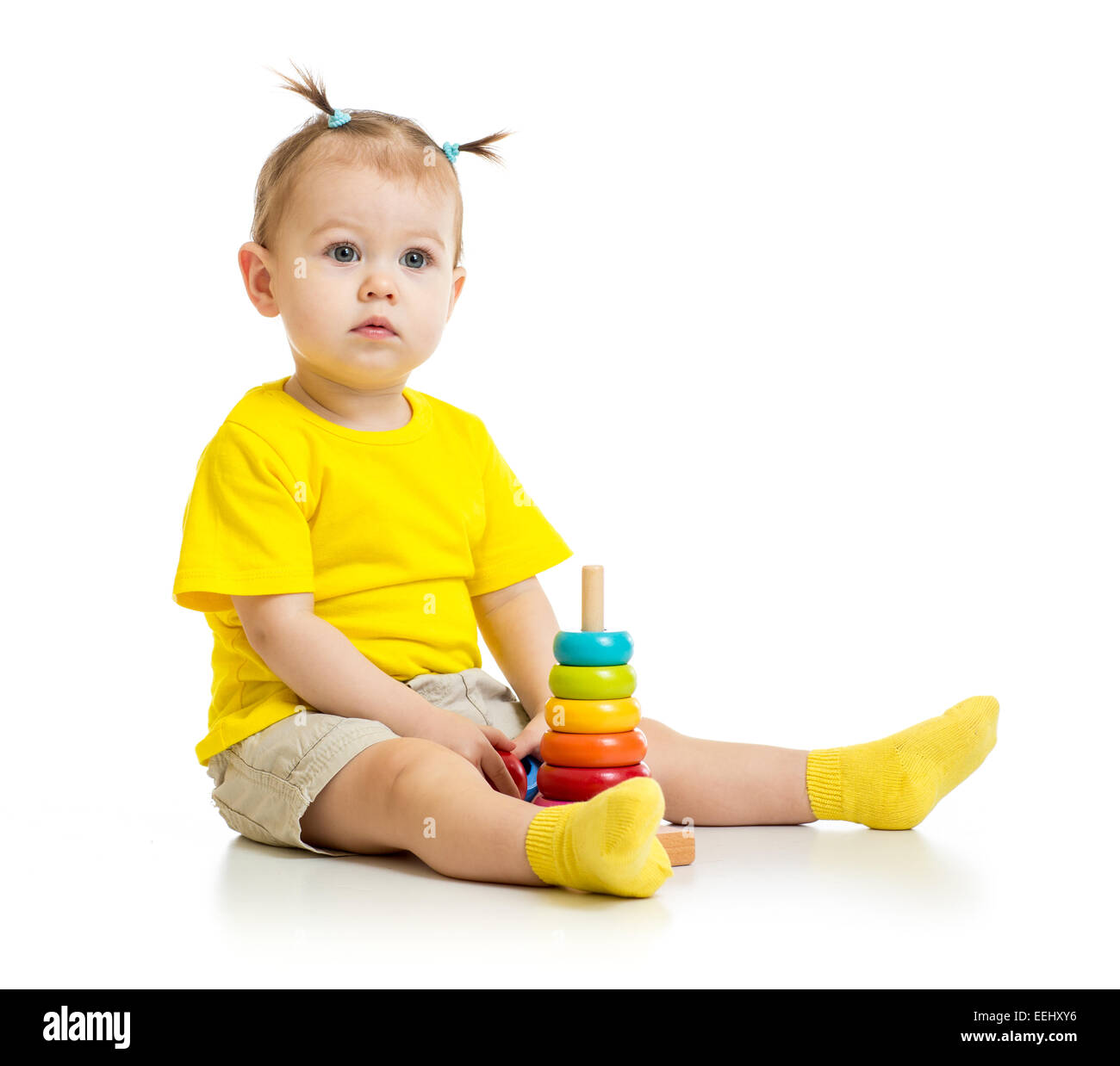 baby playing with colorful wood pyramid isolated - Stock Image