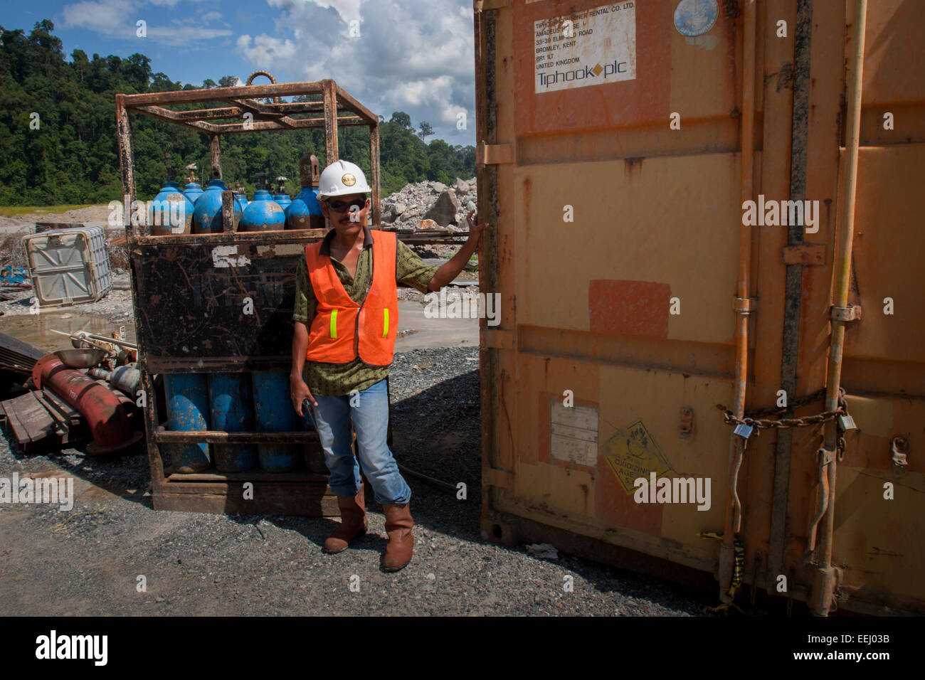 Portrait of a worker in industrial protective clothing at Kelian mine closure project in East Kalimantan, Indonesia. - Stock Image