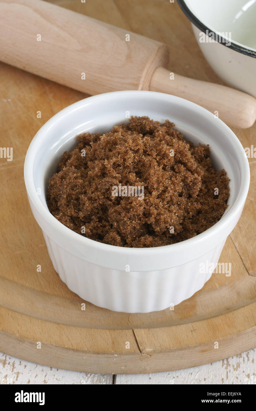 Dark Muscovado Sugar an unrefined organic brown sugar with a strong molasses flavor also known as as molasses or Stock Photo