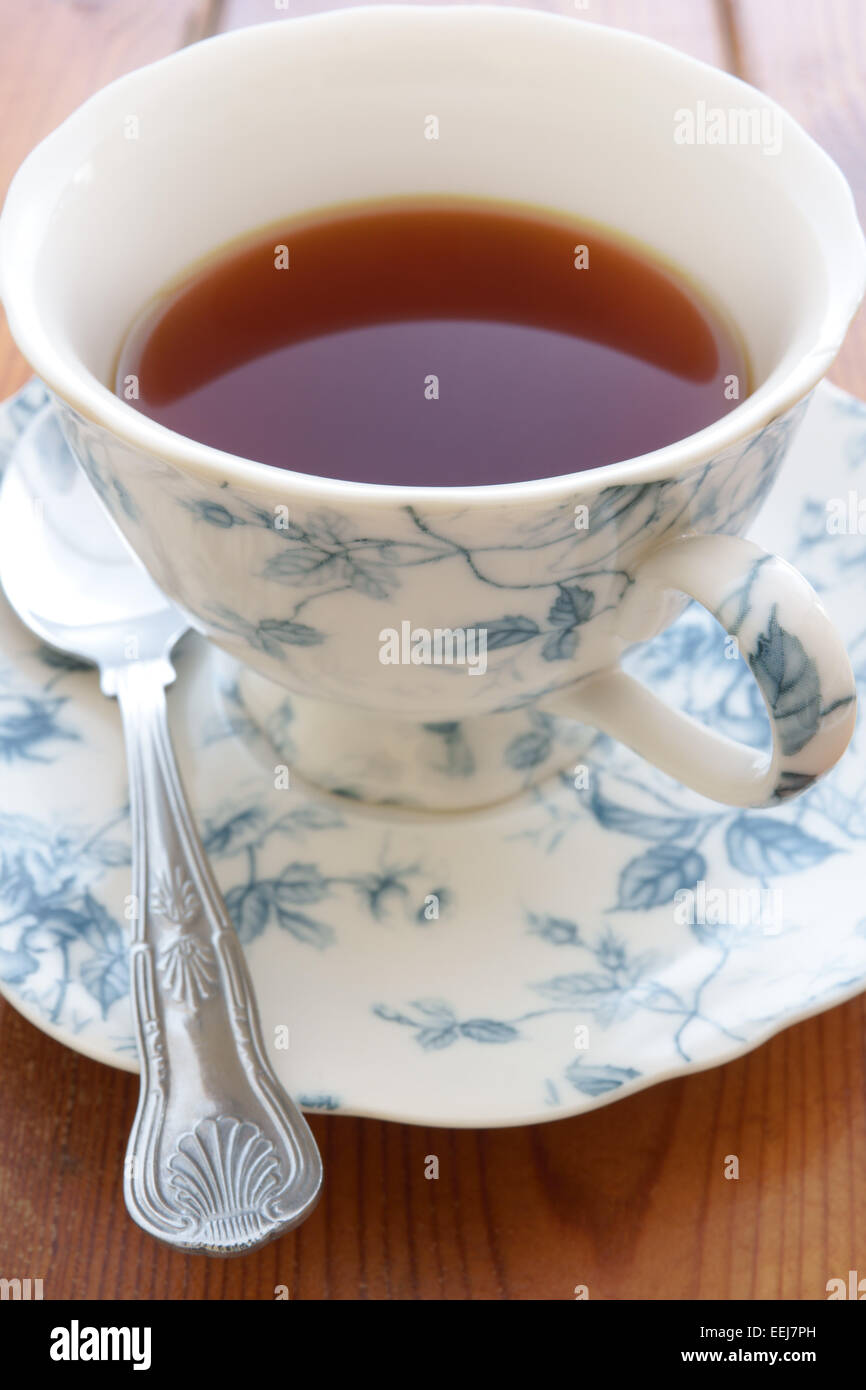 Tea in an ornate china cup - Stock Image