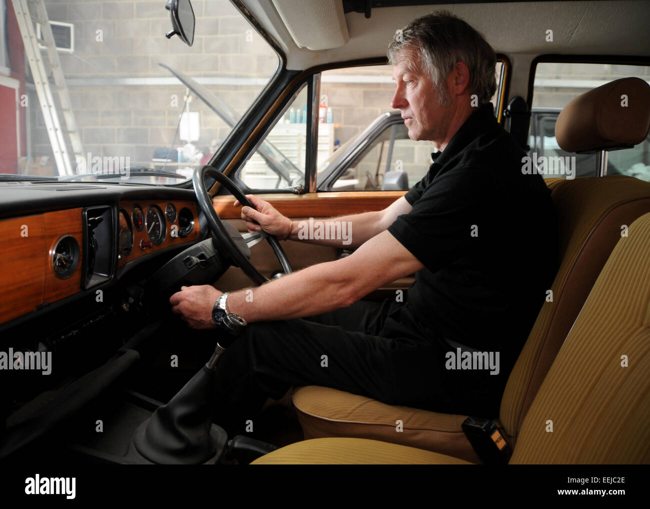 Man turning the ignition key of an older car Stock Photo: 77851270 ...