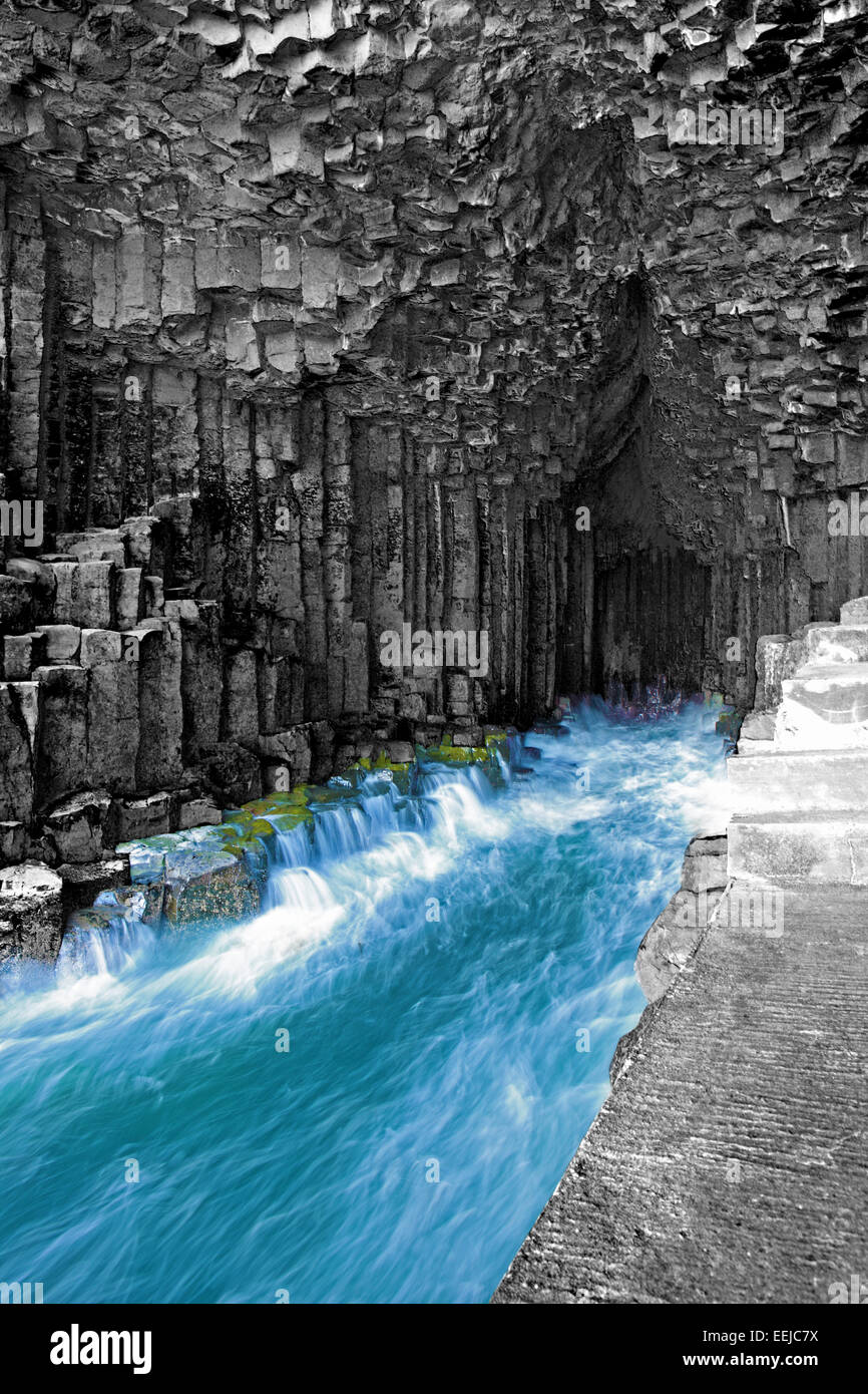 Inside Fingal's Cave enclosed by impressive hexagonal basalt columns on the uninhabited island of Staffa in - Stock Image