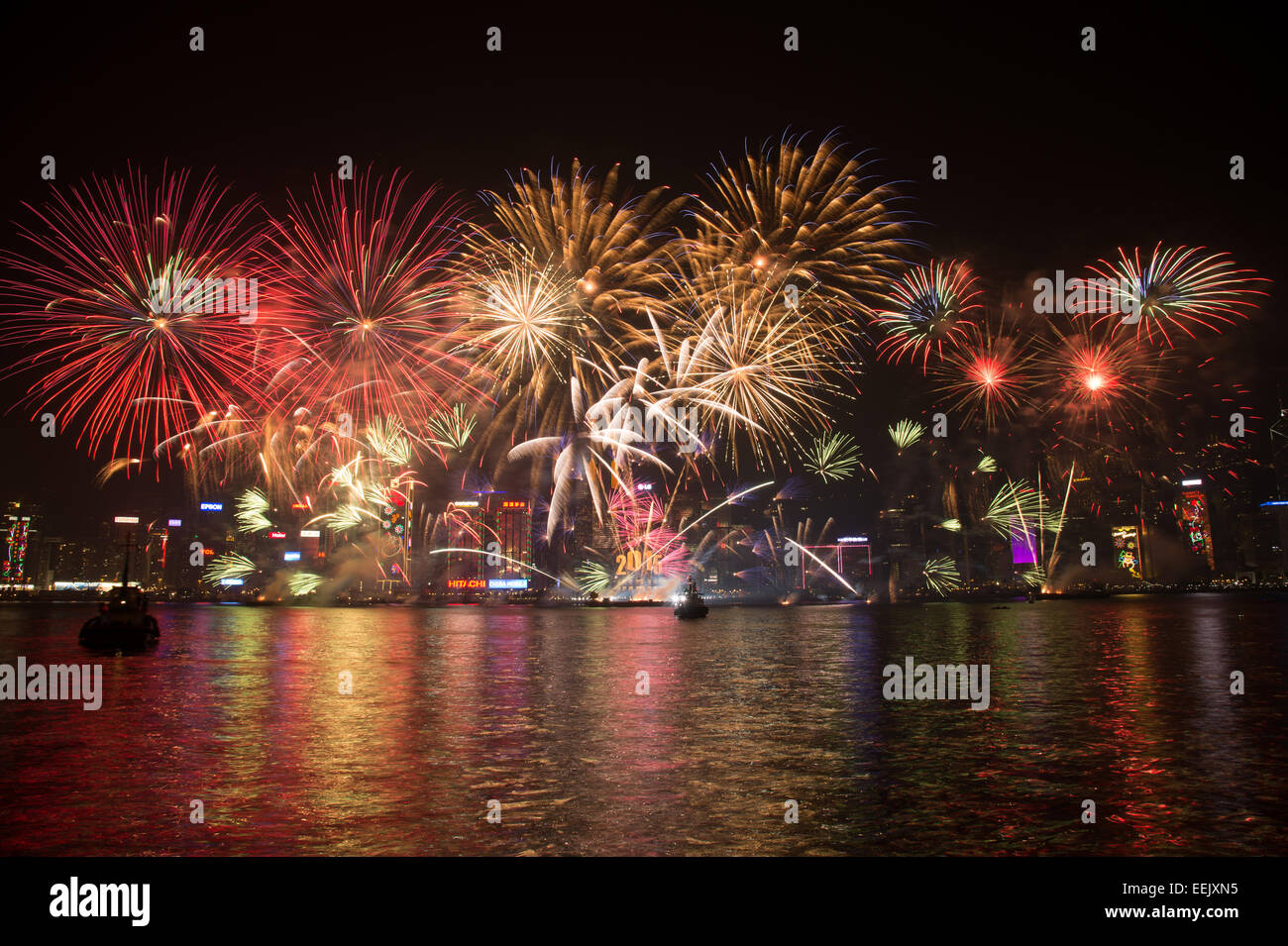 Firework show for the celebrating the New Year Eve 2015 in Victoria Harbour Hong Kong. - Stock Image