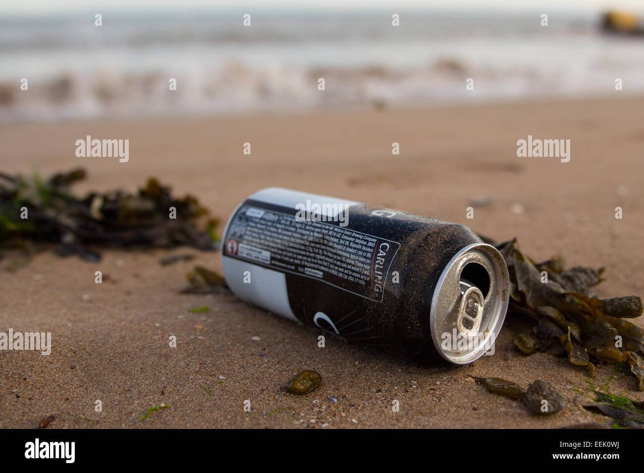 A discarded tin can on a beach at Porthcawl, South Wales. - Stock Image