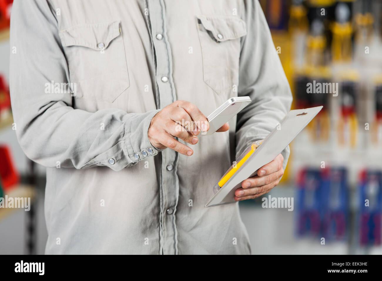 Customer Scanning Tool Packet Through Mobilephone - Stock Image