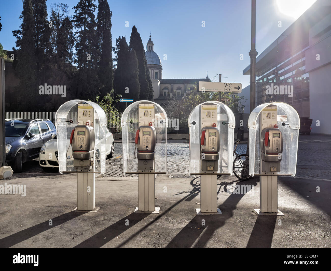 Four public telephones in a row in Rome - Stock Image