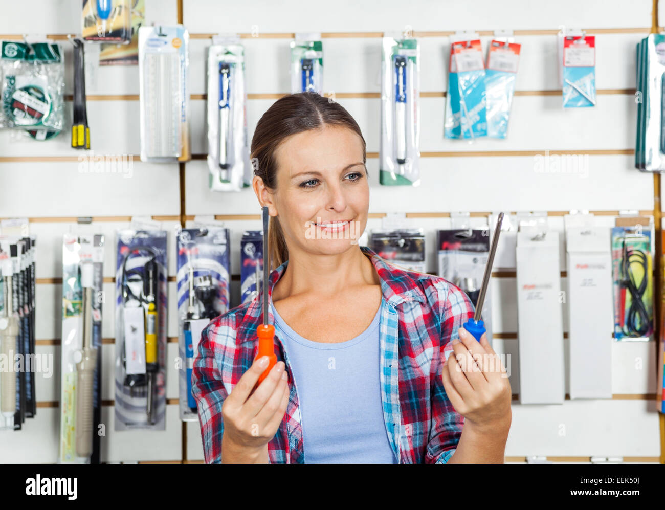 Customer Comparing Screwdrivers In Store - Stock Image