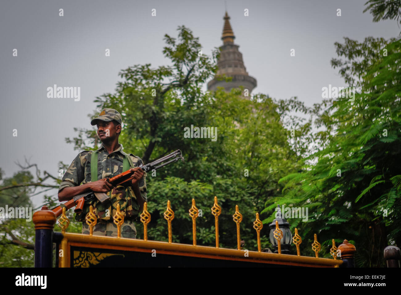 Indian military personnel guards Mahabodhi temple a day after a bomb blast on July 7, 2013. - Stock Image