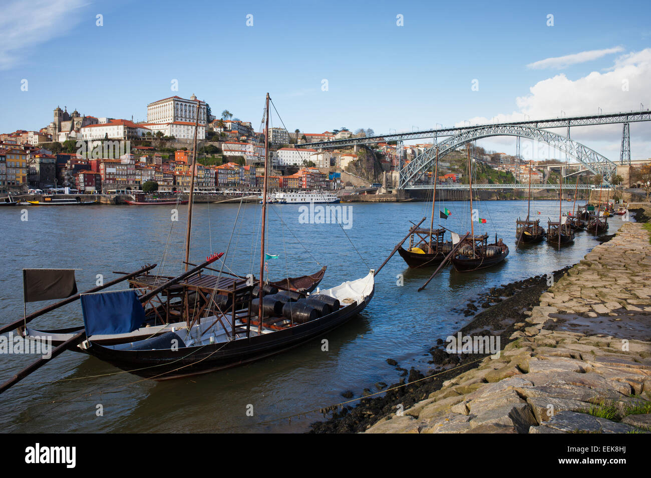 Rabelo traditional boats on Douro river, Dom Luis I Bridge and old city of Porto in Portugal. Stock Photo