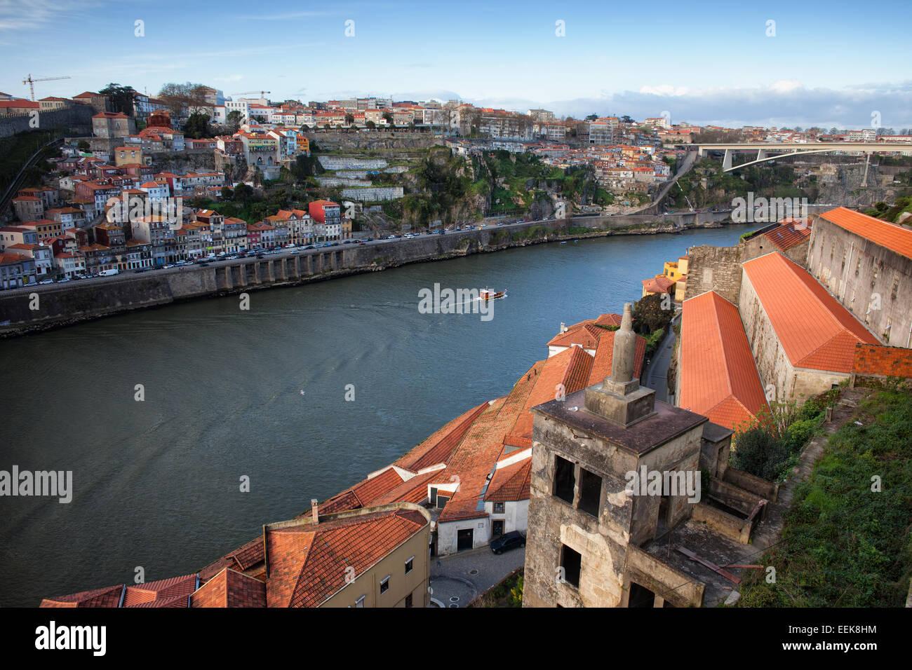 City of Porto in Portugal, on the first plan wine cellar rooftops of Vila Nova de Gaia. - Stock Image