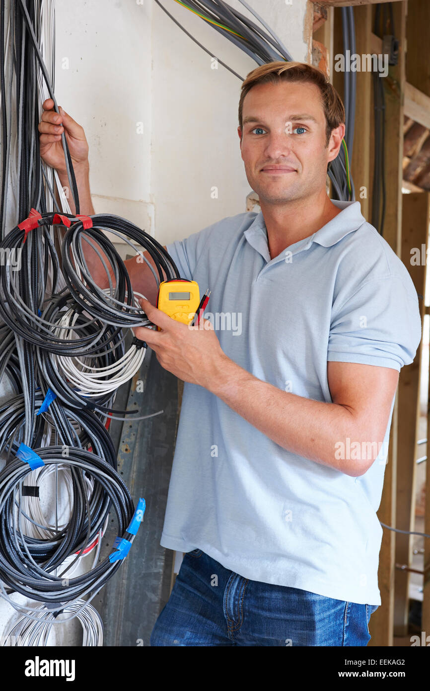 House Wiring Stock Photos Images Alamy Job Description Electrician Fitting On Construction Site Image