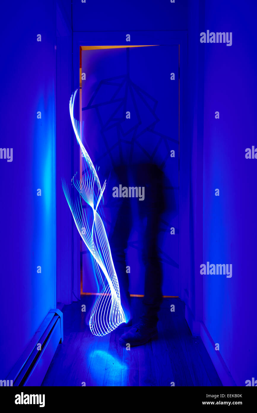 Whimsical light painting forms with LED light stick - Stock Image