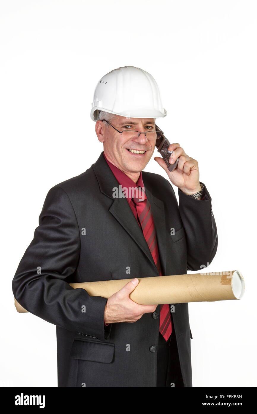 Architekt mit Bauhelm, telefoniert,  Architekt with safety-helmet telephones - Stock Image