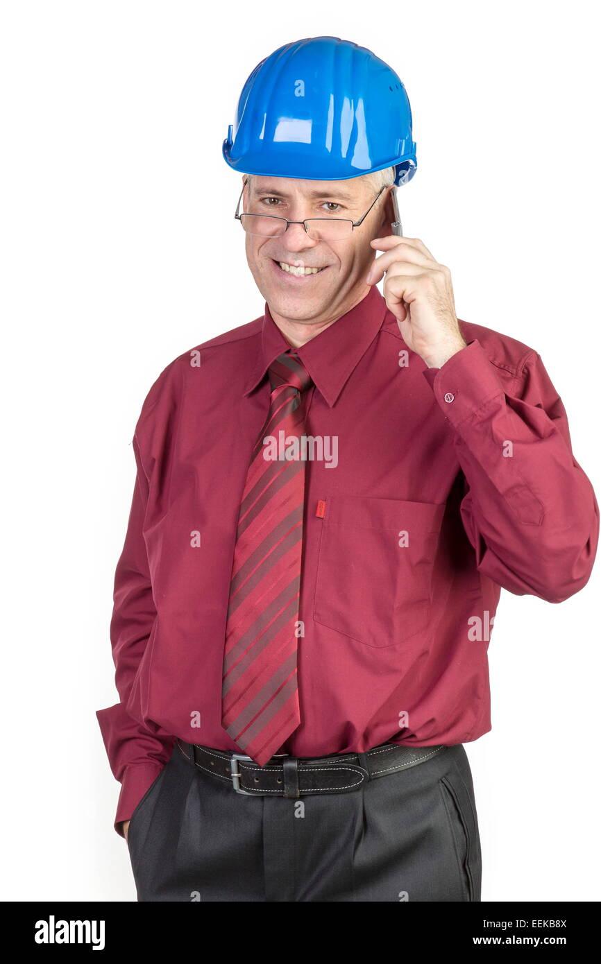 Architekt mit Bauhelm, telefoniert,  Architekt with safety-helmet telephones Stock Photo