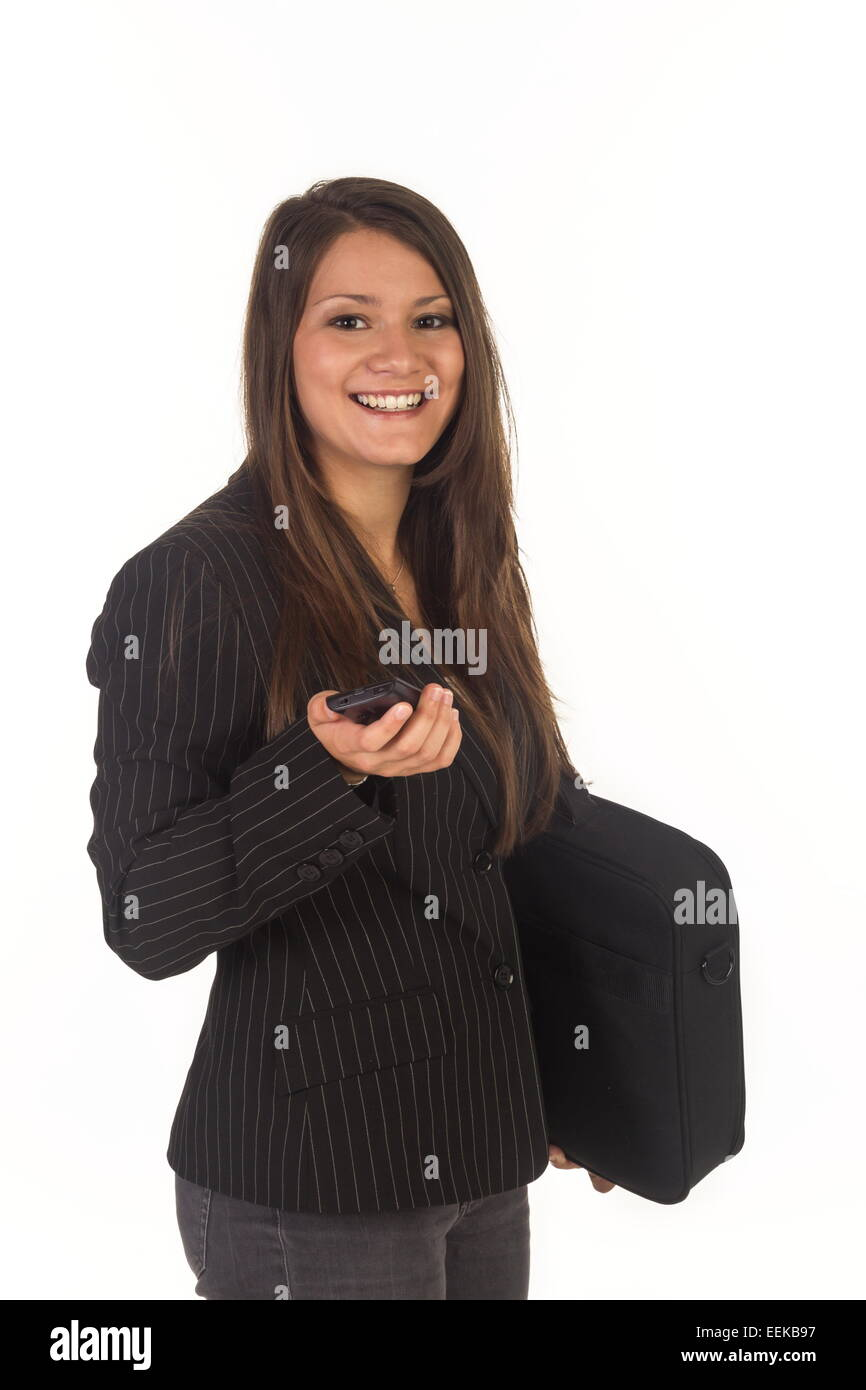 Junge dunkelhaarige Frau mit Aktentasche und Handy, Young dark-haired woman with a briefcase and cell phone Stock Photo