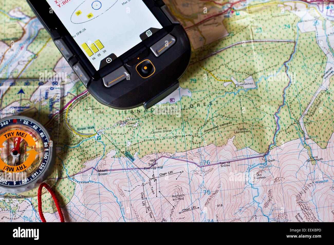 Paper map,compass and modern GPS unit. Navigation, outdoor explorer concept. Outdoor Navigation - Stock Image