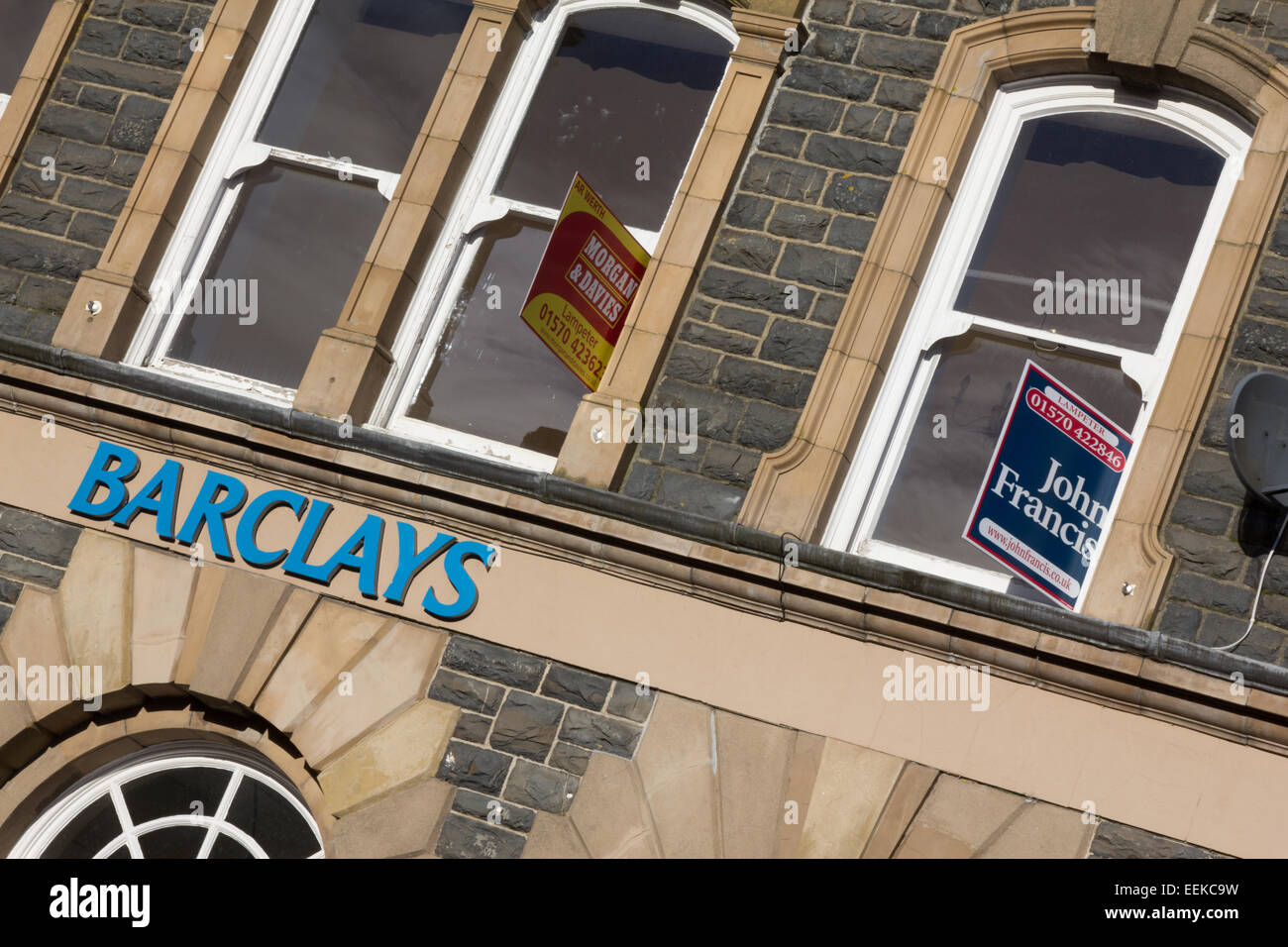 Barclays bank closure at Tregaron in mid Wales. Estate agents' for sale signs outside. Stock Photo