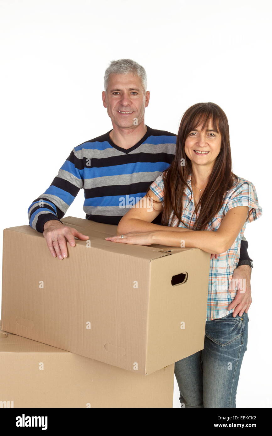 Paar mittleren Alters mit Umzugskartons, Middle-aged couple with removal boxes Stock Photo