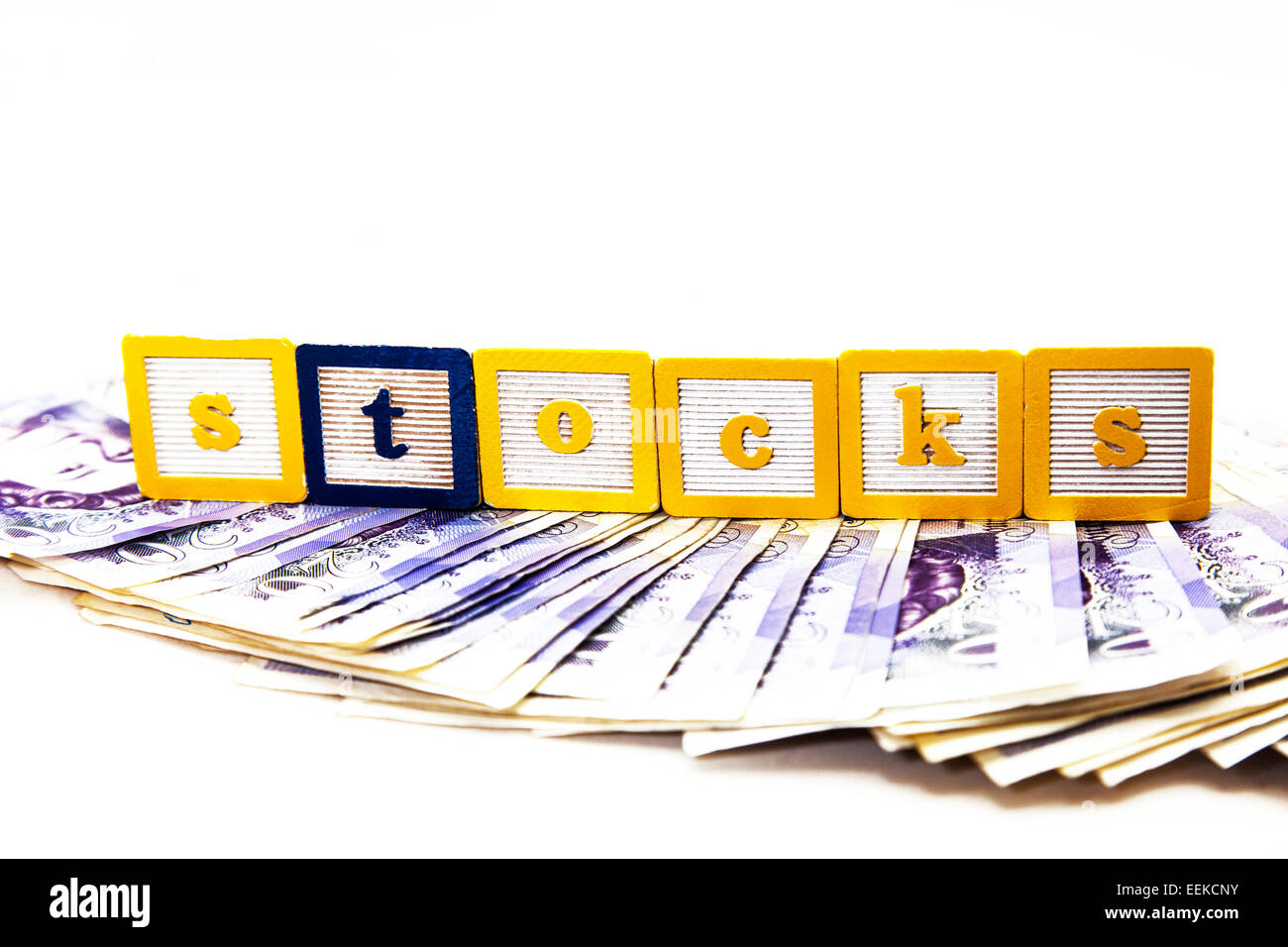 Stocks shares money making FTSE gamble invest investment cash reward rewards dividend cut out copy space white background - Stock Image