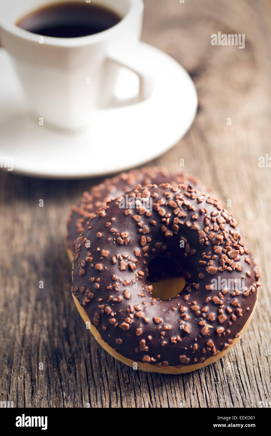 the chocolate donuts and coffee - Stock Image